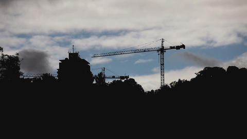 Crane And Building Silhouette With Cloudy Sky Timelapse stock footage