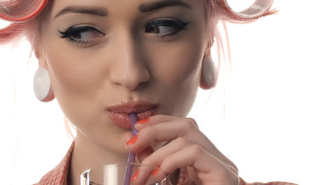 beauty woman portrait of pin-up girl drinking juice Stock Video Footage