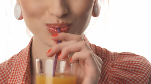 girl beautiful female lips drinking juice Footage