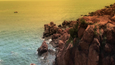 Ocean water surface and rock reef coastal at dusk Stock Video Footage
