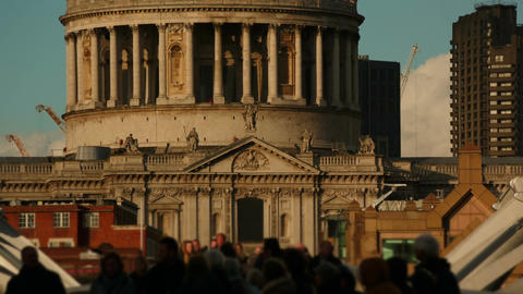 Anonymous crowds walking past the famous St Pauls Cathedral in London, England,  Footage