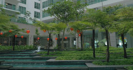 View of picturesque garden with fountain against modern building. Kuala Lumpur,  Live Action