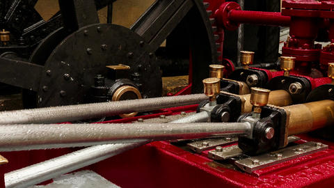 Closeup view of an old hydraulic engine operating outdoors ビデオ