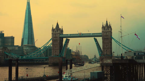 Tower Bridge opening its lifts to a large clipper in London, England, UK Footage