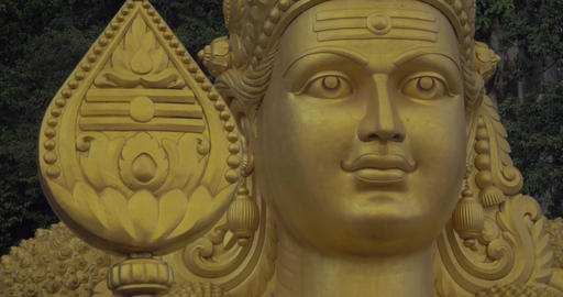Close-up of head of statue of Murugan at Batu Caves, Malaysia Footage