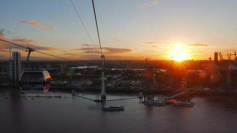 Golden hour sunset aerial shot showing the river Thames and the Greenwich penins