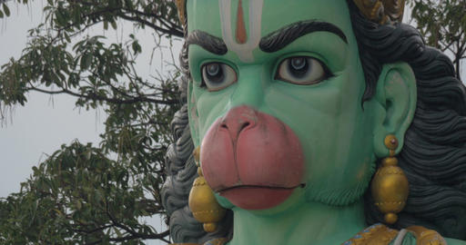 Close-up of head of statue of Hanuman at Batu Caves, Malaysia Footage