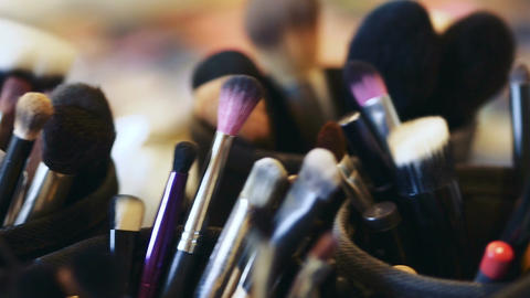 Closeup of professional cosmetics makeup brushes kit in motion ビデオ