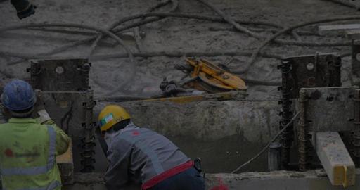 View of worker welding reinforcement of constructed building. Hong Kong, China Footage