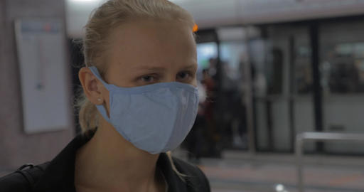 In Hong Kong, China in subway a young girl wears a medical mask Footage