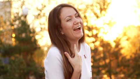 Happy positive woman look to camera and give laugh, slow motion portrait shot Footage