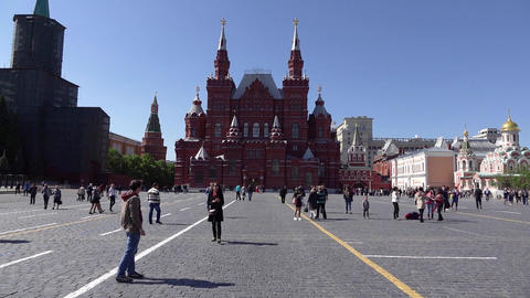 Sightseers and citizens on Red Square, POV camera walk towards Historical Museum Footage