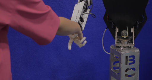In Moscow, Russia on exhibition Robotix expo robot with arm shakes hands with gi Footage