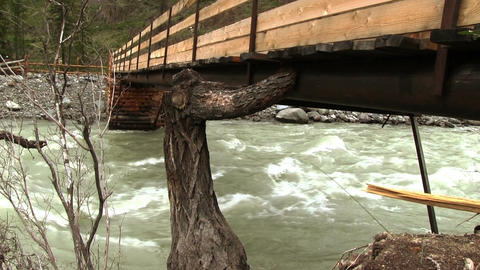 Wooden Bridge Over Mountain River Footage