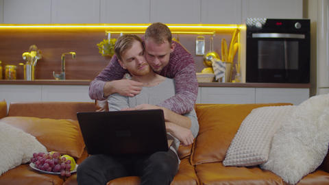 Loving lgbt partners sharing lovely emotions indoor Live Action