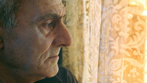 old man suffers looking at the window Live Action