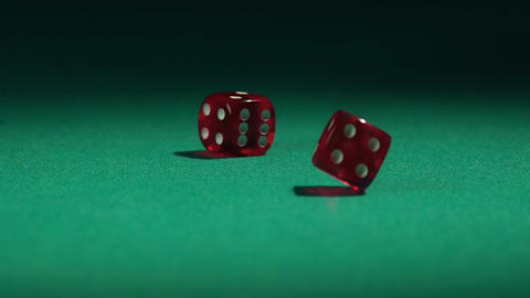 Gambling game at casino, dice falling on table in slow motion. Wealth or poverty Live Action