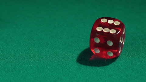 Person rolling dice on green casino table, closeup. Addiction to gambling Footage