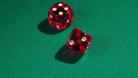 Macro view of red dice falling on green table, playing game at the Vegas casino Footage