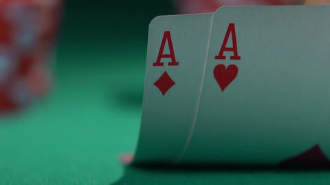 Extreme close-up of poker cards, player checking his hand before making a bet Footage