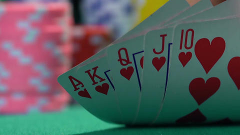 Lucky poker player showing great cards, royal flush. Winning hand, success Footage