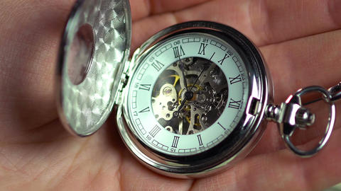 Pocket watch in male hand, minutes of human life, history. Time passing by Footage