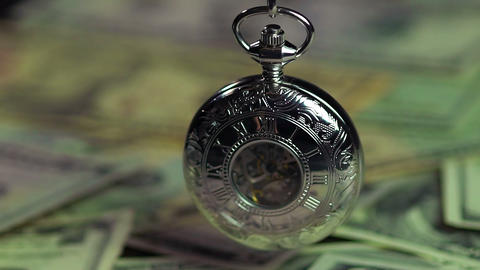 Silver pocket watch and dollars, time is running out like money. Time management Footage