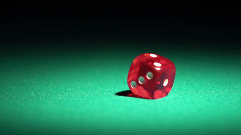 Red casino dice rolling on green table in slow motion, chances to win, gambling Live Action
