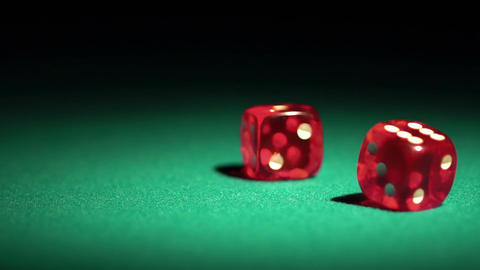 Rolling dice in slow-motion. Gambler enjoying the chance to win a game in casino Footage