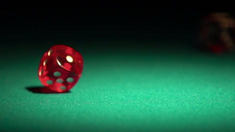 Player throwing red dice on the table, gambling game in casino, chances to win Footage