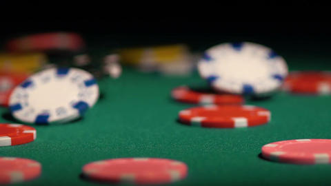 Many poker chips falling on green casino table, gambler winning the super prize Footage