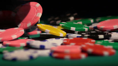 Colored chips falling on the green poker table. Successful player winning game Footage