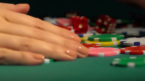 Female hands collecting huge pile of chips off poker table. Leader winning prize Footage