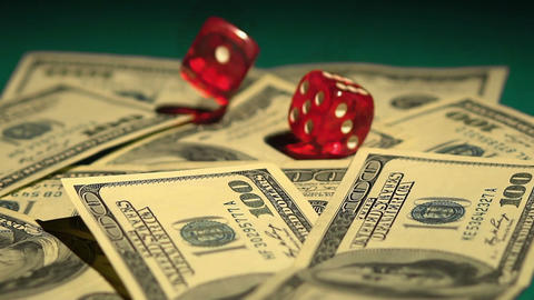 Dice falling on money, odds to win. Stock exchange gambling, risky investments Footage