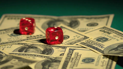 Dice rolling on money, risky financial investments, stock exchange gambling Footage