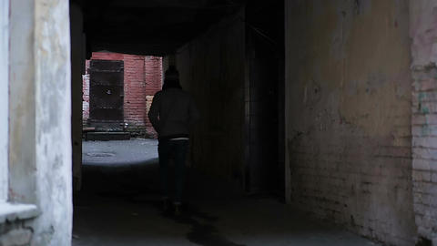 Hopelessly abandoned backstreet, lonely teenager walking alone, has no friends Footage