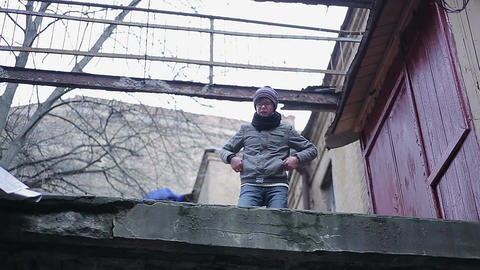 Lonely boy wandering on roof of abandoned building, transitional age crisis Footage