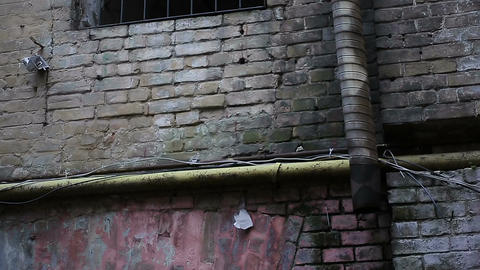 Old brick building with grated window, imprisonment place, no chance to escape Live Action