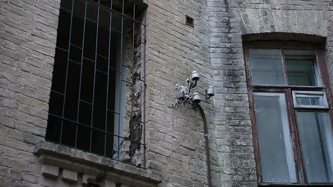 Ruins of abandoned building after enemy attack during war, grated broken window Footage