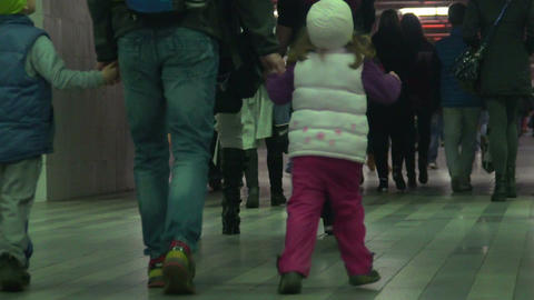 Children and adults walking through underpass, people traveling, slow-motion Live Action