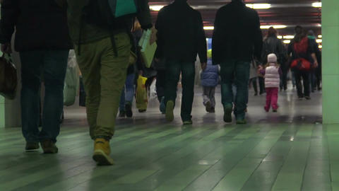 Crowded underground passage, people walking at subway station, slow-motion Footage
