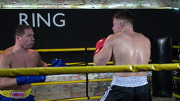 Two boxers fight training in boxing ring HD slow motion video. Fighters sparring Footage