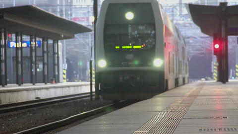 Modern train arriving at railway station, transportation services industry Footage