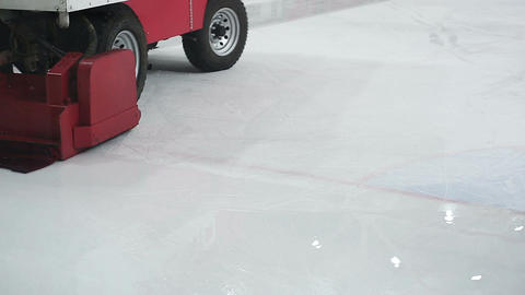Resurfacer vehicle cleaning white ice rink surface, preparations for competition Footage