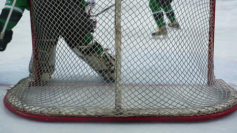 Critical moment in ice hockey match, goaltender preventing rival from scoring Footage