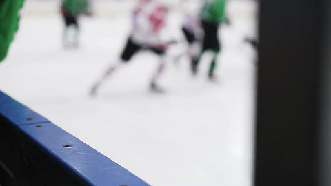 Defocused silhouettes of hockey players and referee during match on ice rink Footage