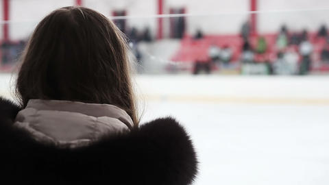 Excited female fan watching hockey match from tribune, supporting national team Footage