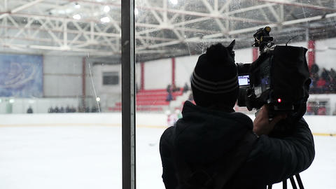 Sports TV channel cameraman filming ice hockey match for report, live broadcast Footage