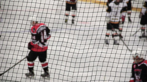 Hockey player shots puck in rival's net, team taking positions before attack Footage