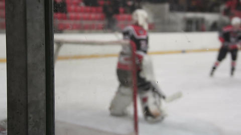 Goalkeeper ready to face rival attack during ice hockey match, defending the net Footage